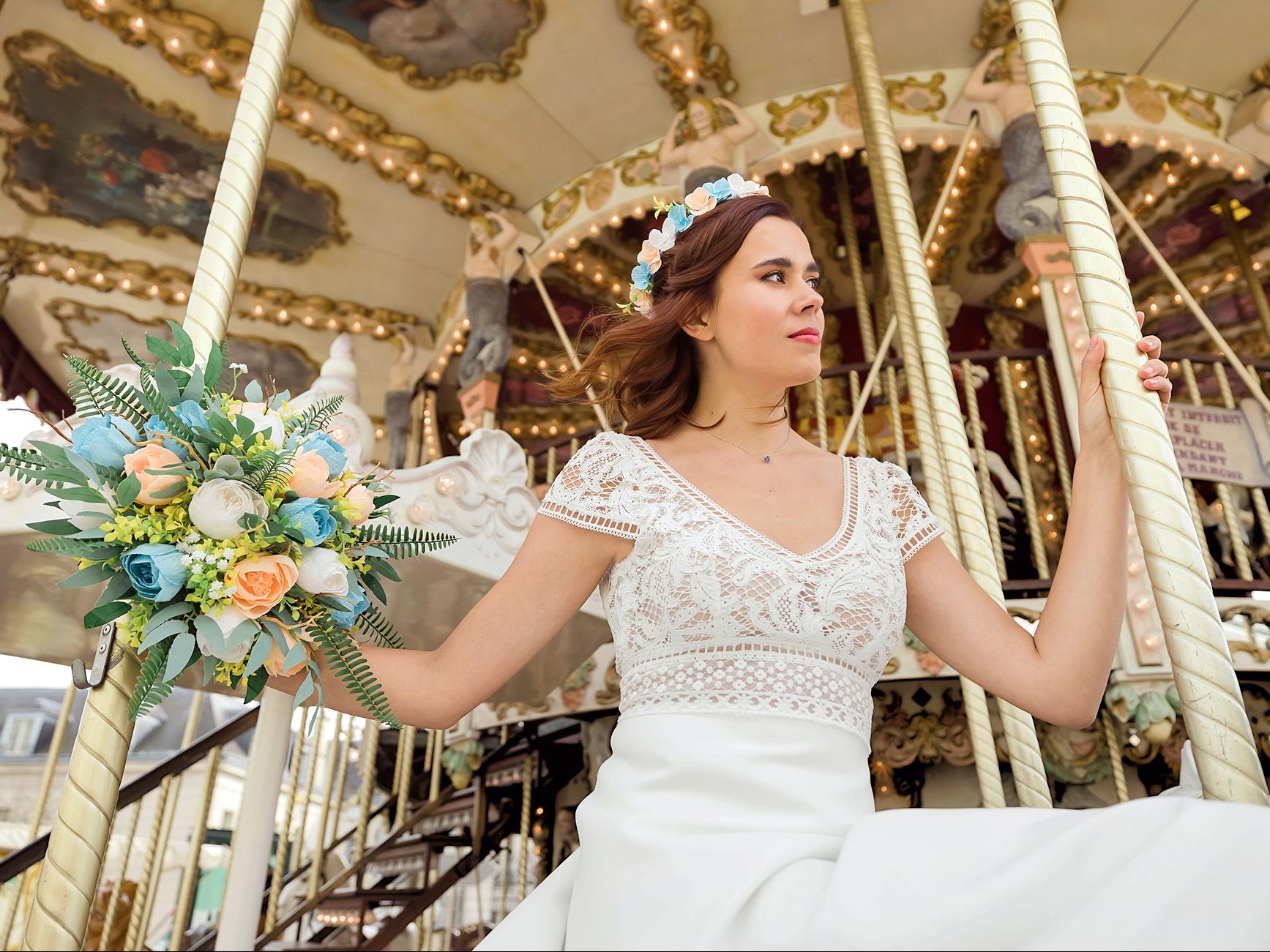 Mariage pastel bleu et vert dans un carrousel